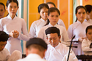 "10 MARCH 2006 - TAY NINH, VIETNAM: Noon services at the Cao Dai main temple in Tay Ninh (formely Saigon) Vietnam. The Cao Dai complex in Tay Ninh is the sect's headquarters. The Cao Dai religion is a blending of Buddhism, Confucianism, Taoism, Christianity and Islam. There ""saints""  include Chinese leader Sun Yat Sen and French author Victor Hugo. There are about two million members of the Cao Dai religion in Vietnam. British author Graham Greene, who wrote about the Cao Dai in the ""The Quiet American"" said the relegion was ""a Walt Disney fantasia of the East."" Photo by Jack Kurtz / ZUMA Press"