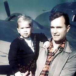 HS708   George H. Bush holds his son, George W. Bush,<br /> Odessa, TX,<br /> 07 Mar 49.<br /> Photo Credit:  George Bush Presidential Library