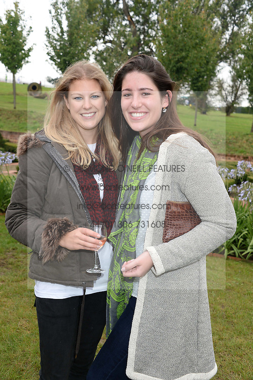 Left to right, LADY RACHEL FITZALAN-HOWARD and ALI SMITH at the Ripley Football Tournament hosted by Irene Forte in aid of The Samaritans held at Ryde Farm, Hungry Hill Lane, Ripley, Surrey on 14th September 2013.  After the football guests enjoyed an after party.