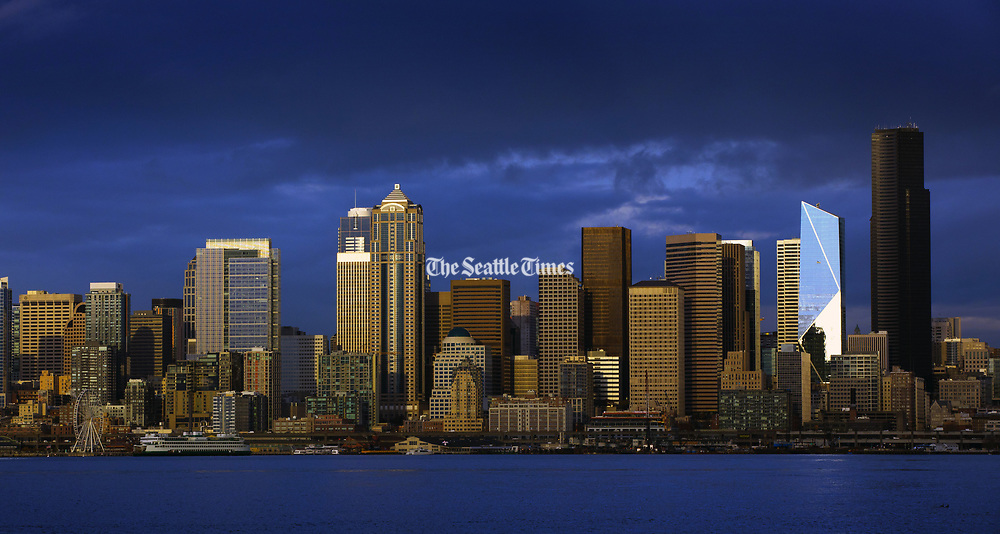 A ferry passes in front of the Seattle skyline as it heads toward the Colman Dock. (Ellen M. Banner/The Seattle Times)