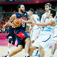 06 August 2012: USA Deron Williams is called for a charging foul on Argentina Facundo Campazzo during 126-97 Team USA victory over Team Argentina, during the men's basketball preliminary, at the Basketball Arena, in London, Great Britain.