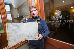 Dacre Stoker, distant relative of Bram Stoker, at the Kilmarnock Arms Hotel, where Bram stayed while writing Dracula, on Bridge St, Cruden Bay, Aberdeenshire. Pic with Bram Stokers' entry in the visitors book.