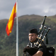 Highland Games, 3rd of August 2019, Newtonmore, Scotland, United Kingdom. A man plays his bag pipe as part of the best bag piper competition. The Highland Games is a traditional annual event where competitors compete as strong men, runners, dancers, pipers and at tug-of-war. The games go back centuries and are happening through-out the summer across Scotland. The games are both an important event locally and a global tourist attraction.