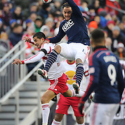 Jermaine Jones, (top), New England Revolution and Tim Cahill, New York Red Bulls, challenge for the ball during the New England Revolution Vs New York Red Bulls, MLS Eastern Conference Final, second leg. Gillette Stadium, Foxborough, Massachusetts, USA. 29th November 2014. Photo Tim Clayton