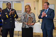Cynthia Smith, center, receives the Business Operations Employee of the Year award from Chief Robert Mock, right, as Asst Chief Michael Benford, right, looks on during the Houston ISD Police awards banquet at Thompson Elementary School, August 15, 2014.