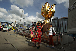 June 25, 2017 - Hong Kong, CHINA - Tourists from Mainland China visit popular sightseeing spot, GOLDEN BAUHINIA PLAZA posing for the cameras. With less than a week for celebration of Hong Kongs 20th anniversary of the HANDOVER to China, Territory is ready for the big event. June 25, 2017.Hong Kong.ZUMA/Liau Chung Ren (Credit Image: © Liau Chung Ren via ZUMA Wire)