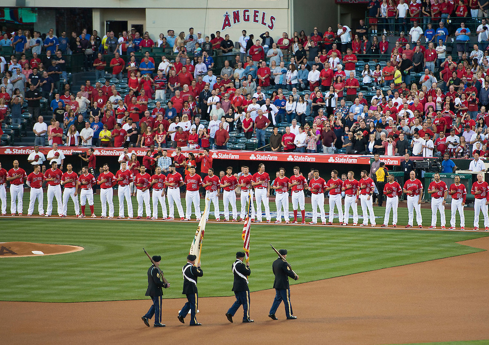 The Angels line up for the National Anthem before their home opener against the Chicago Cubs Monday at Angel Stadium.<br /> <br /> ///ADDITIONAL INFO:   <br /> <br /> angels.0405.kjs  ---  Photo by KEVIN SULLIVAN / Orange County Register  --  4/4/16<br /> <br /> The Los Angeles Angels take on the Chicago Cubs during their 2016 home opener Monday at Angel Stadium.<br /> <br /> <br />  4/4/16