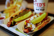 SHOT 10/20/17 9:20:55 AM - A pair of Ted's hot dogs, fries and a drink at Ted's Hot Dogs in downtown Buffalo, N.Y. Buffalo, N.Y. is the second most populous city in the state of New York and is located in Western New York on the eastern shores of Lake Erie and at the head of the Niagara River. By 1900, Buffalo was the 8th largest city in the country, and went on to become a major railroad hub, the largest grain-milling center in the country and the home of the largest steel-making operation in the world. The latter part of the 20th Century saw a reversal of fortunes: by the year 1990 the city had fallen back below its 1900 population levels. (Photo by Marc Piscotty / © 2017)