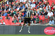 Dannie Bulman of AFC Wimbledon heads the ball over Carl McHugh of Plymouth Argyle. Skybet football league two play off final match, AFC Wimbledon v Plymouth Argyle at Wembley Stadium in London on Monday 30th May 2016.<br /> pic by John Patrick Fletcher, Andrew Orchard sports photography.