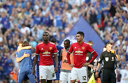 Manchester United's Paul Pogba (left) and Chris Smalling stands dejected after the game