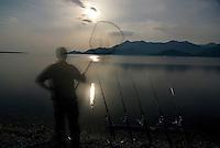 Fisherman and fishing rods on Lake Skadar, Montenegro