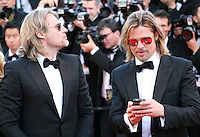 Director Andrew Dominik and Actor Brad Pitt photographing the press photographers with his phone at the Killing Them Softly gala screening at the 65th Cannes Film Festival France. Tuesday 22nd May 2012 in Cannes Film Festival, France.