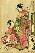 Two geishas dressing for a festival, 1785. One is putting on a sock with shaping for big toe. Lamp with paper shade, front right. Kitagawa Utamaro (1753-1806) JapaneseUukiyo-e artist. Female Courtesan Entertainer Fashion Kimono