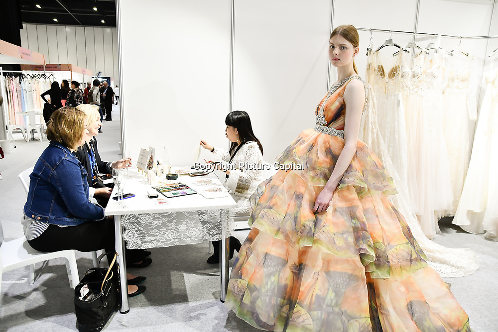 Exhibitors and model at White Gallery at London Bridal Fashion Week at London Excel on 25 March 2019, UK.