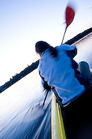 Young woman kayaking on Lake Ossipee, New Hamshire<br />