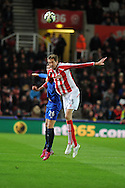 Peter Crouch of Stoke city jumps above John Stones of Everton. Barclays Premier League match, Stoke city v Everton at the Britannia Stadium in Stoke on Trent , Staffs on Wed 4th March 2015.<br /> pic by Andrew Orchard, Andrew Orchard sports photography.