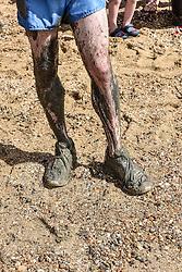 The muddy legs of a runner.