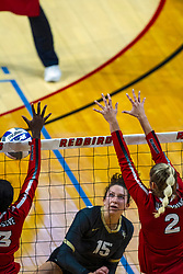 BLOOMINGTON, IL - September 14: Kristina Fisher strikes the ball towards Emmy Ogogor and Taylor Lynch during a college Women's volleyball match between the ISU Redbirds and the University of Central Florida (UCF) Knights on September 14 2019 at Illinois State University in Normal, IL. (Photo by Alan Look)