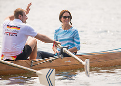 The Duchess of Cambridge after taking part in a rowing race between teams representing the twinned towns of Heidelberg and Cambridge in Heidelberg, Germany, on day three of their five-day tour of Poland and Germany.