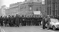 Police, RUC, halt two of the 20th October 1976 funerals of three members of the Provisional  IRA who died on 16th October 1976 when the bomb they were planting at Belfast Gasworks exploded prematurely, until Irish Tricolours are removed from the coffins. The three who died were Paul Marlowe, 32 years, Francis Fitzsimmons, 29 years, and Joseph Surgeoner, 24 years.  197610200431b<br /> <br /> Copyright Image from Victor Patterson, 54 Dorchester Park, Belfast, UK, BT9 6RJ<br /> <br /> t1: +44 28 9066 1296 (from Rep of Ireland 048 9066 1296)<br /> t2: +44 28 9002 2446 (from Rep of Ireland 048 9002 2446)<br /> m: +44 7802 353836<br /> <br /> victorpattersonbelfast@gmail.com<br /> victorpatterson@me.com<br /> <br /> www.victorpatterson.com<br /> <br /> Please see my Terms and Conditions of Use at https://www.victorpatterson.com/page2<br /> It is IMPORTANT that you familiarise yourself with them.<br /> <br /> Images used on the Internet incur an additional cost and must be visibly watermarked i.e. © Victor Patterson within the body of the image and copyright metadata must not be deleted. Images used on the Internet have a size restriction of 4kbs and are chargeable at rates available at victorpatterson.com.<br /> <br /> This image is available only for the use of the download recipient i.e. television station, newspaper, magazine, book publisher, etc, and must not be passed on to any third party. It is also downloaded on condition that each and every usage is notified within 7 days to victorpatterson@me.com<br /> <br /> The right of Victor Patterson (or the named photographer) to be identified as the author is asserted in accordance with The Copyright Designs And Patents Act (1988). All moral rights are asserted.