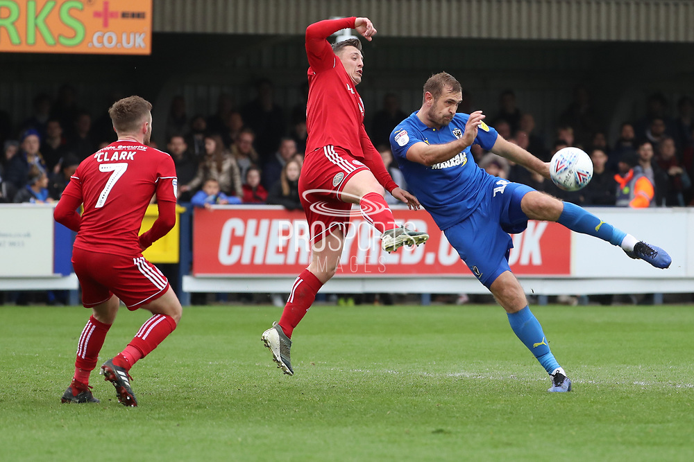 AFC Wimbledon striker James Hanson (18) about to volley the ball during the EFL Sky Bet League 1 match between AFC Wimbledon and Accrington Stanley at the Cherry Red Records Stadium, Kingston, England on 6 April 2019.