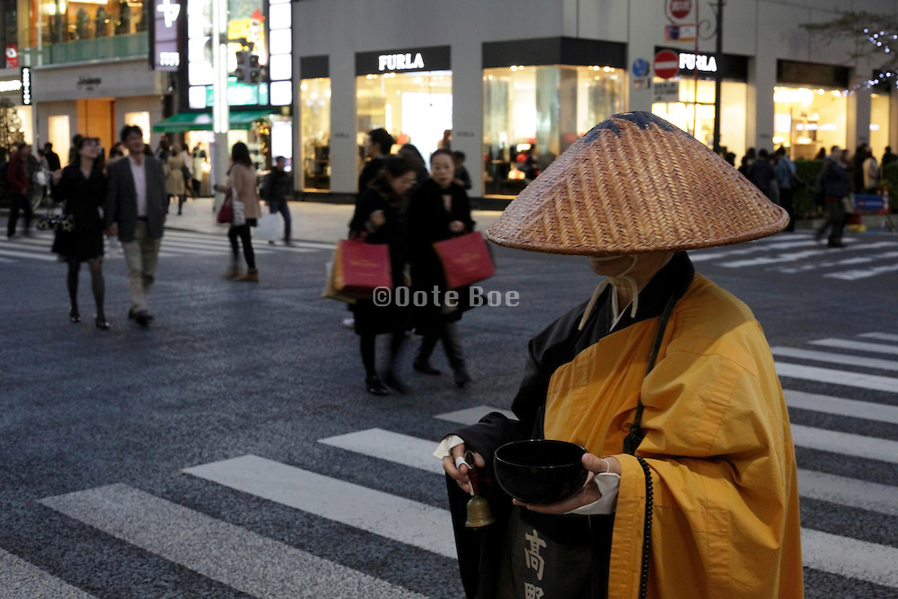 Shinto monk in traditional dress collecting alms Tokyo Ginza