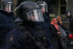 A couple watch as police gather ahead of an anti-G7 demonstration in Quebec City, PQ, Canada on Thursday June 7, 2018, ahead of the G7 summit. Photo by Chris Young/CP/ABACAPRESS.COM