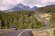 A motorist travels the Haines Highway connecting Alaska with British Columbia and the Yukon Territory.
