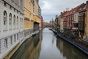 Reflections of buildings of different sizes and styles in the Muinkschelde canal in Ghent, in the East Flanders region of Belgium