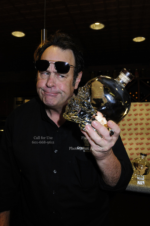 1/28/13 New Orleans LA.-Actor Dan Aykroyd signs bottles of his Crystal  Head vodka at Rouse's Supermarket prior to Super Bowl XLV11 in New Orleans. Photo©Suzi Altman