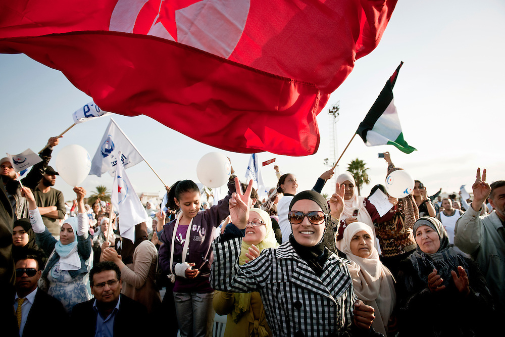 USE ARROWS ← → on your keyboard to navigate this slide-show<br /> <br /> Tunis, Tunisia, 21 October 2011<br /> Campaign meeting of Ennahdha, an Islamist political party running for the elections of October 23rd 2011.<br /> Photo: Ezequiel Scagnetti