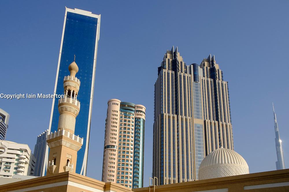 Skyline of skyscrapers and minaret in Dubai United Arab Emirates