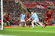 Roberto Firmino of Liverpool (r) heads past Huddersfield Town Goalkeeper Jonas Lossl to score his teams 2nd goal. Premier League match, Liverpool v Huddersfield Town at the Anfield stadium in Liverpool, Merseyside on Saturday 28th October 2017.<br /> pic by Chris Stading, Andrew Orchard sports photography.