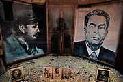 Shop window with portraits of Fidel Castro facing the recently deceased leader of the USSR, Leonid Brezhnev, July 1984, Havanna, Cuba. Fidel Alejandro Castro Ruz was a Cuban revolutionary and politician who governed the Republic of Cuba as Prime Minister from 1959 to 1976 and then as President from 1976 to 2008. Cubas independence from American imperialism was maintained with the ecanomic assistance of the USSR. Aditional images of other revolutionaries, including Lenin and Marx are joined by the Cubans Che Guevara and Camilo Cienfuegos.