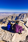 Hikers enjoying the view from the summit of Mount Whitney, Sequoia National Park, California USA