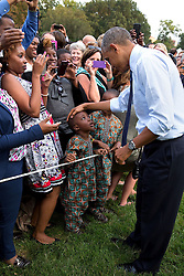 President Barack Obama greets a child during an event for political appointees on the South Lawn of the White House, Sept. 15, 2014. (Official White House Photo by Pete Souza)<br /> <br /> This official White House photograph is being made available only for publication by news organizations and/or for personal use printing by the subject(s) of the photograph. The photograph may not be manipulated in any way and may not be used in commercial or political materials, advertisements, emails, products, promotions that in any way suggests approval or endorsement of the President, the First Family, or the White House.