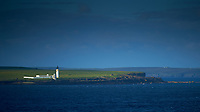 Stroma Island Lighthouse off the North Coast of Scotland from the Deck of the MV Explorer. Image taken with a Nikon Df camera and 70-200 mm f/4 VR lens (ISO 100, 200 mm, f/4, 1/1000 sec). Raw image processed with Capture One Pro, Focus Magic, and Photoshop CC.