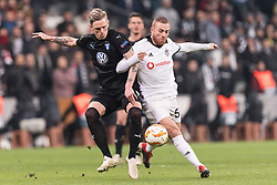 (L-R) Soren Rieks of Malmo FF, Gokhan Tore of Besiktas JK during the UEFA Europa League group I match between between Besiktas AS and Malmo FF at the Besiktas Park on December 13, 2018 in Istanbul, Turkey