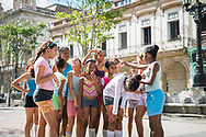 Cuban school girls prepare to do the physical education portion of their day on the Prado (Paseo de Marti) in Havana, Cuba. (December 4, 2014)