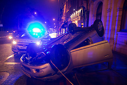 © Licensed to London News Pictures. 10/01/2014. London, England. A Toyota car today flipped over during a busy Friday afternoon rush hour in Archway Road, Highgate, North London and landed on its roof on the pavement. According to the police, no other cars were involved in this incident and the cause is being investigated. The accident occurred at the junction of Archway Road/Southwood Lane/Muswell Hill Road and caused major tailbacks. Photo credit: Bettina Strenske/LNP