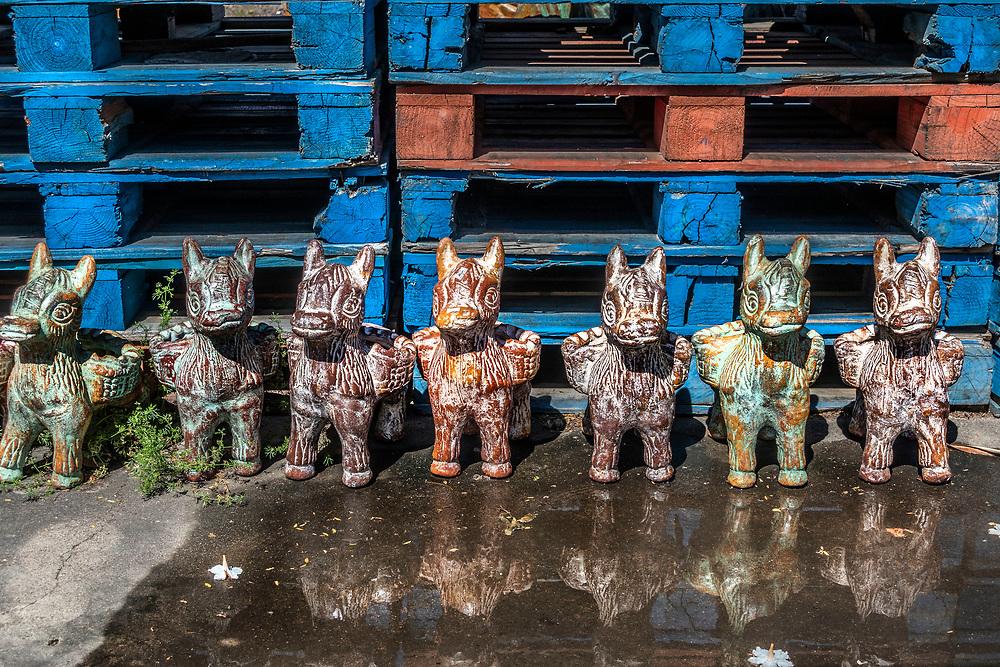 Pottery animal planters on sale at a roadside shop, Texas, USA