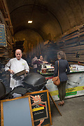 A busy weekend at Maltby Street Market on 17th October 2015 in London, United Kingdom. Opening in 2010, Maltby Street is an artisan food market under the railways arches in Bermondsey, London.