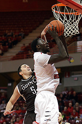 """27 November 2015: Joseph Tagarelli can't write stop the shot by Daouda """"David"""" Ndiaye (4). Illinois State Redbirds host the Quincy Hawks at Redbird Arena in Normal Illinois (Photo by Alan Look)"""