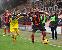 Bournemouth's Charlie Daniels shields the ball from Watford's Daniel Pudil - Photo mandatory by-line: Alex James/JMP - Tel: Mobile: 07966 386802 18/01/2014 - SPORT - FOOTBALL - Goldsands Stadium - Bournemouth - Bournemouth v Watford - Sky Bet Championship