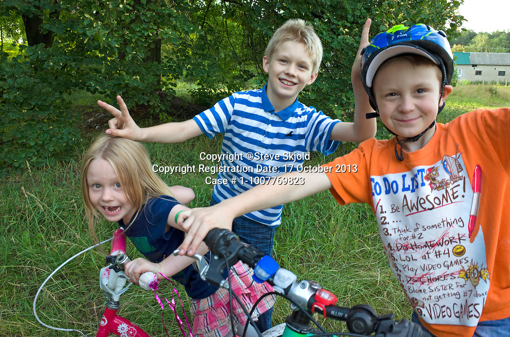 Happy children giving their grandfather photographer Steve Skjold a rousing Polish welcome. Zawady Central Poland