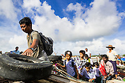 13 JUNE 2013 - YANGON, MYANMAR:     Passengers get off a boat at the Aung Mingalar Jetty in Yangon. The jetty is a stop for commuters who live on the far side of the Irrawaddy River and ride small boats back and forth across the river. Yangon, formerly Rangoon, is Myanmar's commercial capital and used to be the national capital. The city is on the Irrawaddy River and has a vibrant riverfront.    PHOTO BY JACK KURTZ