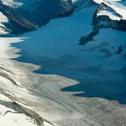 Chigmit Mountains rise sharply above Lake Clark National Park, Alaska