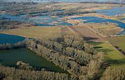 Nederland, Gelderland, Millingerwaard, 11-02-2008; ooibossen in de Millingerwaard, natuurontwikkelingsgebied in het hart van de Gelderse Poort; het gebied, aan de zuidoever van de Waal (boven in beeld) oostelijk van Nijmegen, is ontstaan door het winnen van klei (kleiputten); tijdens hoog water verandert de Millingerwaard in een kilometersbrede overstromingsvlakte...luchtfoto (toeslag); aerial photo (additional fee required); .foto Siebe Swart / photo Siebe Swart