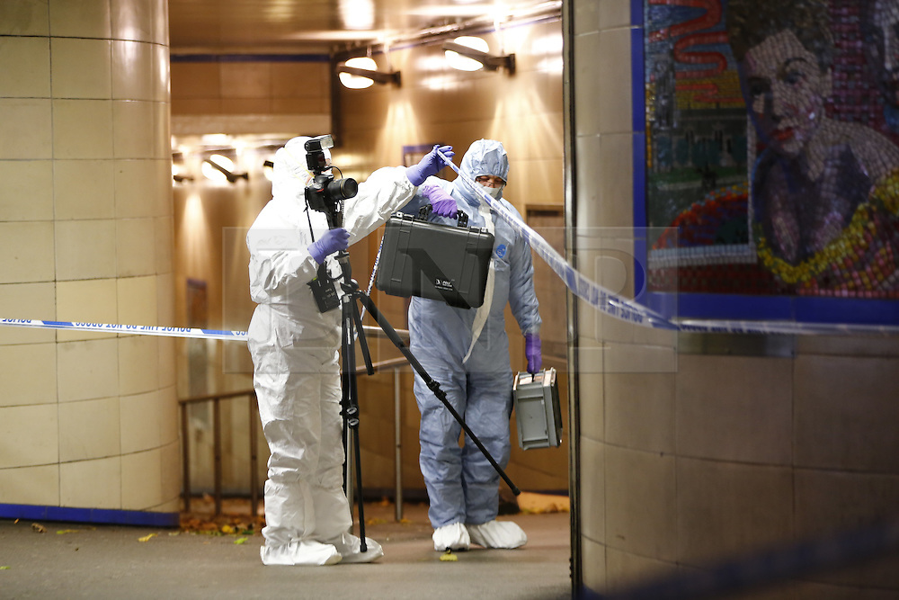 """© Licensed to London News Pictures. 05/12/2015. London, UK. Police officers investigating a crime scene at Leytonstone tube station in east London after a man was seriously injured in a knife attack. The attacker reportedly shouted """"This is for Syria"""" during the attack. Photo credit: Tolga Akmen/LNP"""