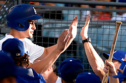 June 10, 2017 - Los Angeles, California, U.S. - Los Angeles Dodgers' Corey Seager high fives teammates after scoring on a RBI sac fly ball by teammate Adrian Gonzalez (not pictured) in the first inning of a Major League baseball game against the Cincinnati Reds at Dodger Stadium on Saturday, June 10, 2017 in Los Angeles. (Photo by Keith Birmingham, Pasadena Star-News/SCNG) (Credit Image: © San Gabriel Valley Tribune via ZUMA Wire)